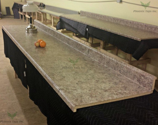 Bordeaux Juparana 4929 38 Countertop on White Kitchen With Grey Granite